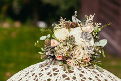 Rustic bride bouquet with roses and succulents on white wedding Royalty Free Stock Photo