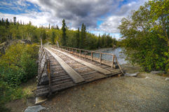 Rustic bridge. A beautiful scene from along the Alaskan Highway in the Yukon Territory Royalty Free Stock Images