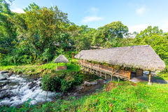 Rustic Bridge near Mindo, Ecuador. Rustic looking bridge with a thatch roof crossing a river in a cloud forest near Mindo, Ecuador Stock Photos