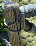 A Rustic Bridge Rail. Constructed of aging Rope and Wood Stock Photography