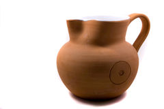 Rustic brown clay milk jug Stock Images