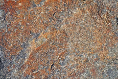 Rustic brown stone background Royalty Free Stock Image