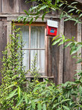 Rustic building and birdhouse Stock Photography
