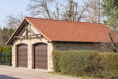 Rustic-built double garage as a man`s dream stock photo