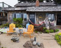 Rustic bungalow at the ocean front. Stock Photography