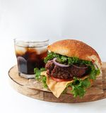 Rustic burgers with a cold drink on wooden Stock Photo