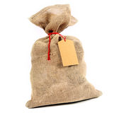 Rustic burlap sack with a gift tag Stock Photo