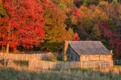 Rustic cabin, autumn colors, cumberland gap national park. An old rustic cabin and autumn foliage in the Cumberland Gap National Park Royalty Free Stock Images