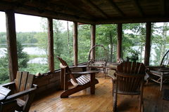 Rustic Cabin Porch with Lake View Royalty Free Stock Images