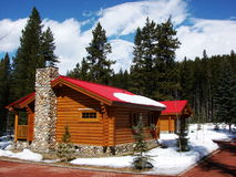 Rustic Cabin with red roof stock image
