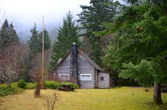 Rustic Cabin in the woods Stock Photo