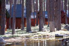 Rustic cabins outdoors in forest, Royalty Free Stock Image