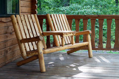 Rustic Camping Chair. A rustic style camping chair beckons to vacationers to sit on the front porch of a cabin and relax in the great outdoors royalty free stock photo