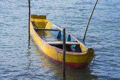 Rustic canoe docked in river Royalty Free Stock Photography