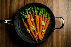 Rustic carrotts in a pan Royalty Free Stock Images