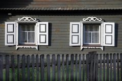 Rustic carved windows. Two white carved windows of a wooden rustic homestead in Lithuania Royalty Free Stock Images