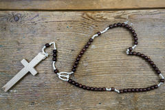 Rustic Catholic rosary and cross Stock Photography