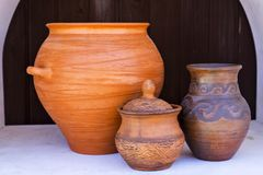 Rustic ceramic ware on the shelf Stock Image