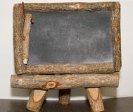 Rustic chalk/note board. A rustic style chalk board for leaving messages at home, work, or school stock photo