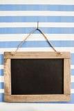 Rustic chalkboard on stripes Stock Image