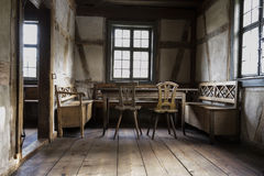 Rustic chamber with bench, table and chair. Royalty Free Stock Image