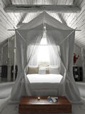 Rustic charming bedroom with draped canopy bed . Royalty Free Stock Photography