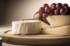 Rustic Cheeseboard with Grapes Royalty Free Stock Image
