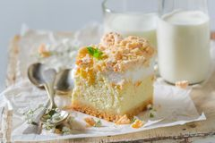 Rustic cheesecake made of peach and crumble. On white background royalty free stock photo