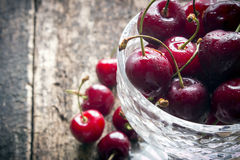 Rustic cherry with water drops close-up selective focus Royalty Free Stock Image