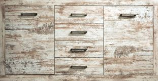Rustic chest drawer of bleached pine wood. Close up, front view stock image