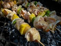 Rustic chicken kebabs stock photography