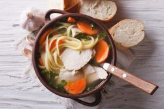 Rustic chicken soup with noodles closeup. Horizontal top view Royalty Free Stock Photo