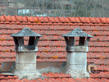 Rustic chimney. Couple of rustic tuscan chimney Royalty Free Stock Photo