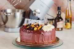 Rustic chocolate cake with cherries and orange Royalty Free Stock Images