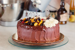 Rustic chocolate cake with cherries and orange Royalty Free Stock Image
