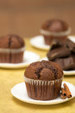 Rustic chocolate muffin. With cinnamon on little white plate Stock Photo