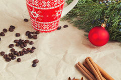 Rustic Christmas background. Coffee, cinnamon, red cup Stock Photography