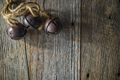 Rustic Christmas Bells. And Wood Background Royalty Free Stock Photos