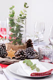 Rustic christmas centerpiece for dinner place setting Royalty Free Stock Photos