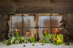 Rustic christmas decoration in green colors with presents and ca Royalty Free Stock Image