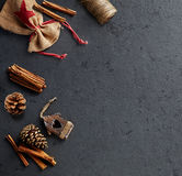 Rustic Christmas Decorations and Spices on dark stone background royalty free stock image