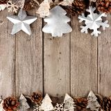 Rustic Christmas double border with metal and bark ornaments on aged wood Stock Photo