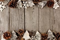 Rustic Christmas double border with wood ornaments on aged wood Stock Image