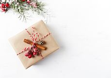 Rustic Christmas gift box with Christmas decorations on white wooden background. Flatlay. Copy space stock images