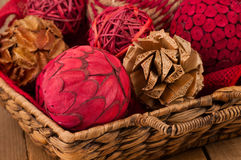 Rustic Christmas Ornaments in a Basket Royalty Free Stock Photography