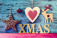 Rustic christmas ornaments and text xmas Royalty Free Stock Photography