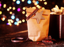 Rustic Christmas package with star and bokeh Royalty Free Stock Photo