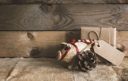 Rustic christmas scene. Rustic christmas background with straw pig and a gift stock photo