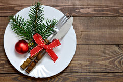 Rustic Christmas table setting. Empty plate and silverware royalty free stock images