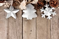 Rustic Christmas top border with metal ornaments on aged wood Stock Image